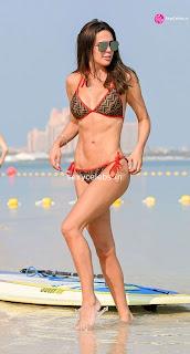 Danielle Lloyd ultra  body huge    in tiny bikini WOW Beach Side  Pics Celebs.in Exclusive 003
