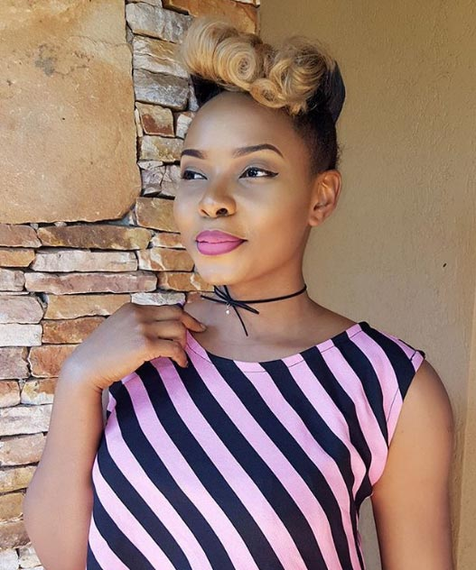 Pretty lady Yemi Alade flashes belly in stripped jumpsuit