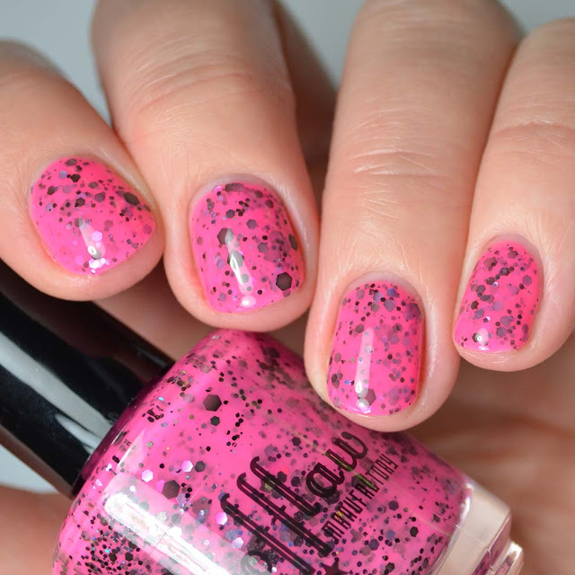 neon pink nail polish with glitter swatch