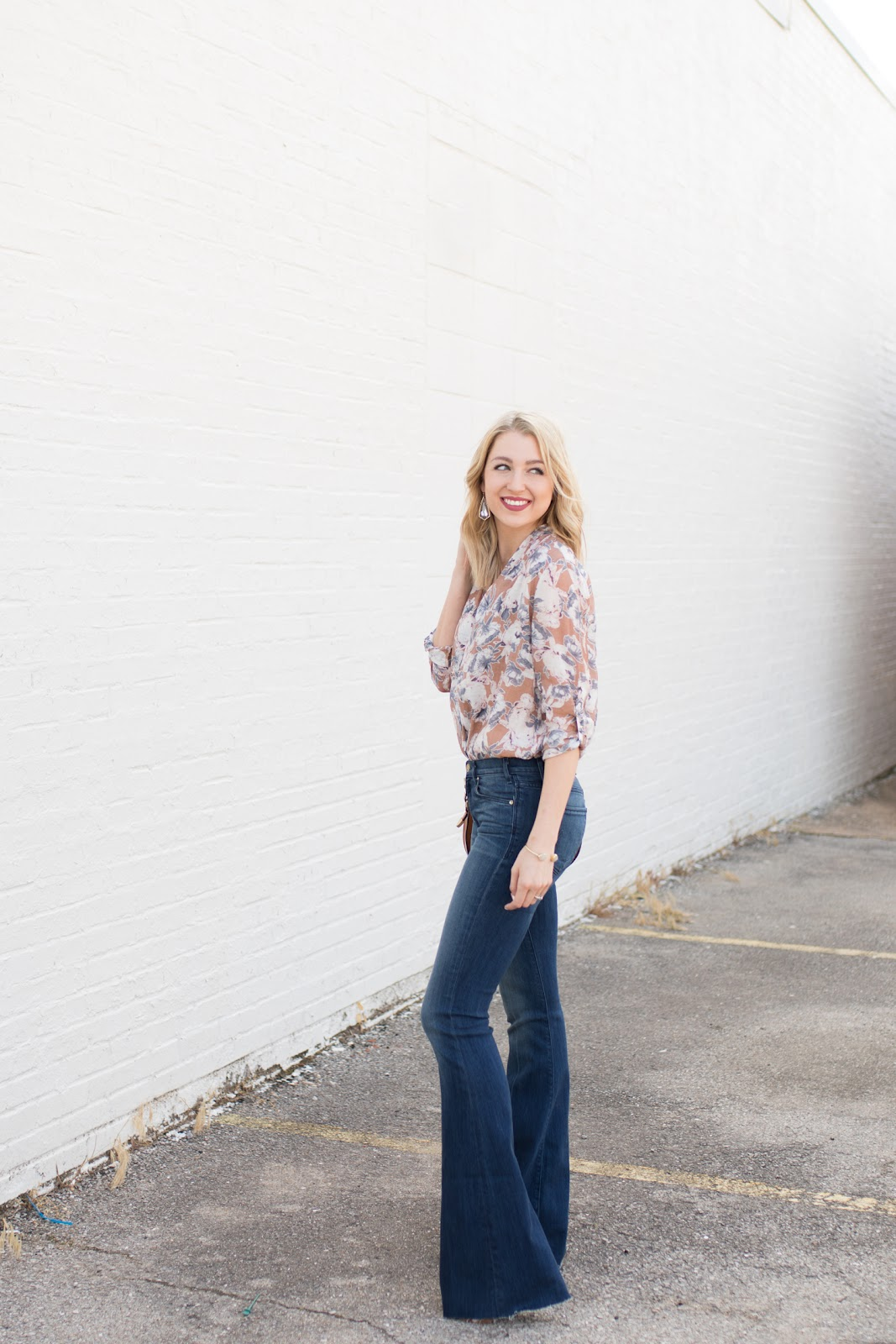Flare jeans with a tucked in blouse
