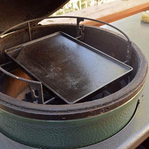 Griddle set up for making smashburgers on a big green egg kamado grill
