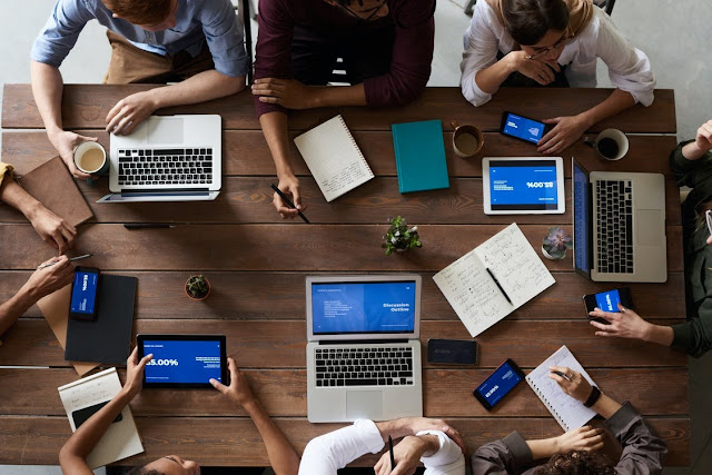 People using different computers to view important business information showing one way to improve internal communication at your business
