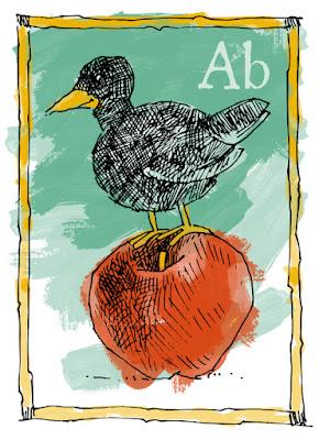 Black bird sitting on an apple