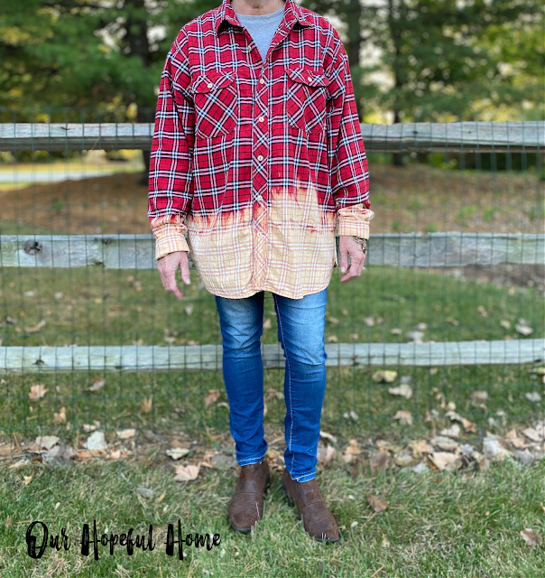 model weating bleached red flannel shirt
