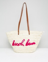http://www.asos.com/missguided/missguided-beach-bum-slogan-straw-bag/prd/7844723?clr=pink&SearchQuery=BEACH&pgesize=36&pge=15&totalstyles=5579&gridsize=3&gridrow=3&gridcolumn=1