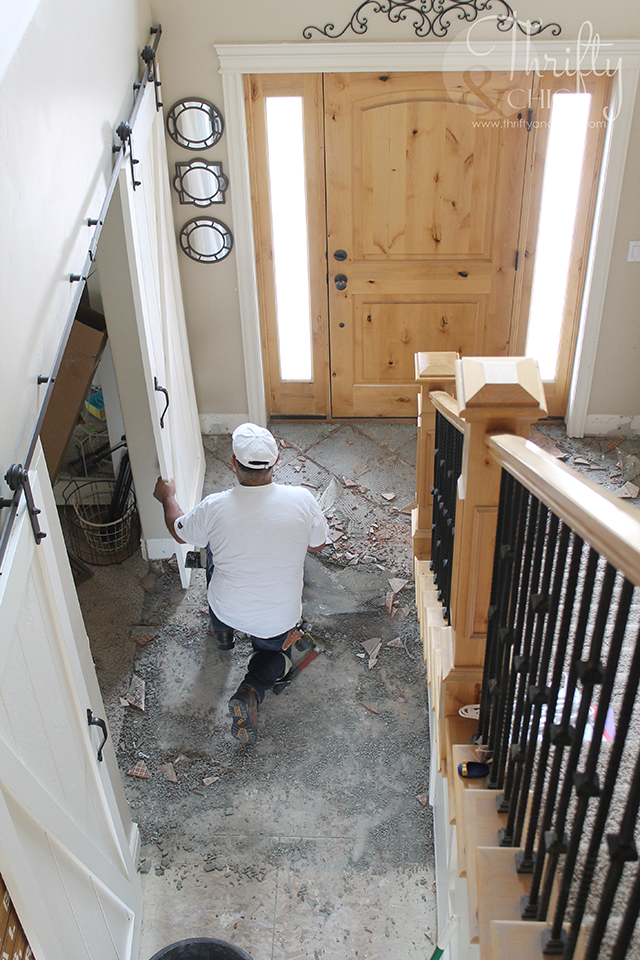 Why we chose laminate versus hard wood flooring. Plus, a glimpse into the installation process!