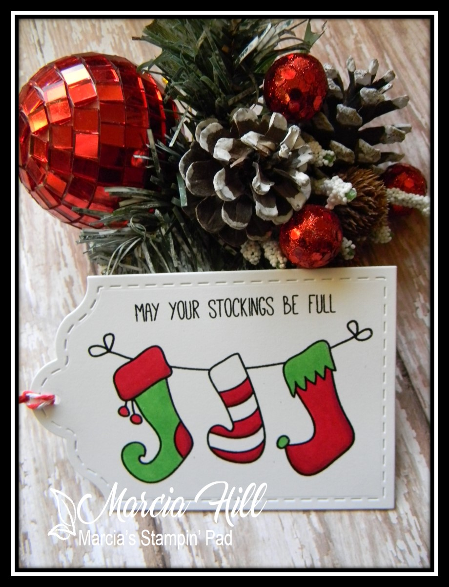 just a simple little tag using avery elles stockings set i embossed the stockings and sentiment in black and then colored with my copics