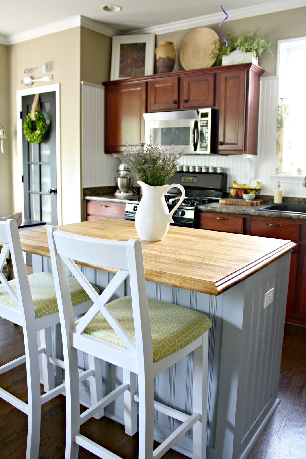 Covering kitchen island with beadboard for farmhouse look