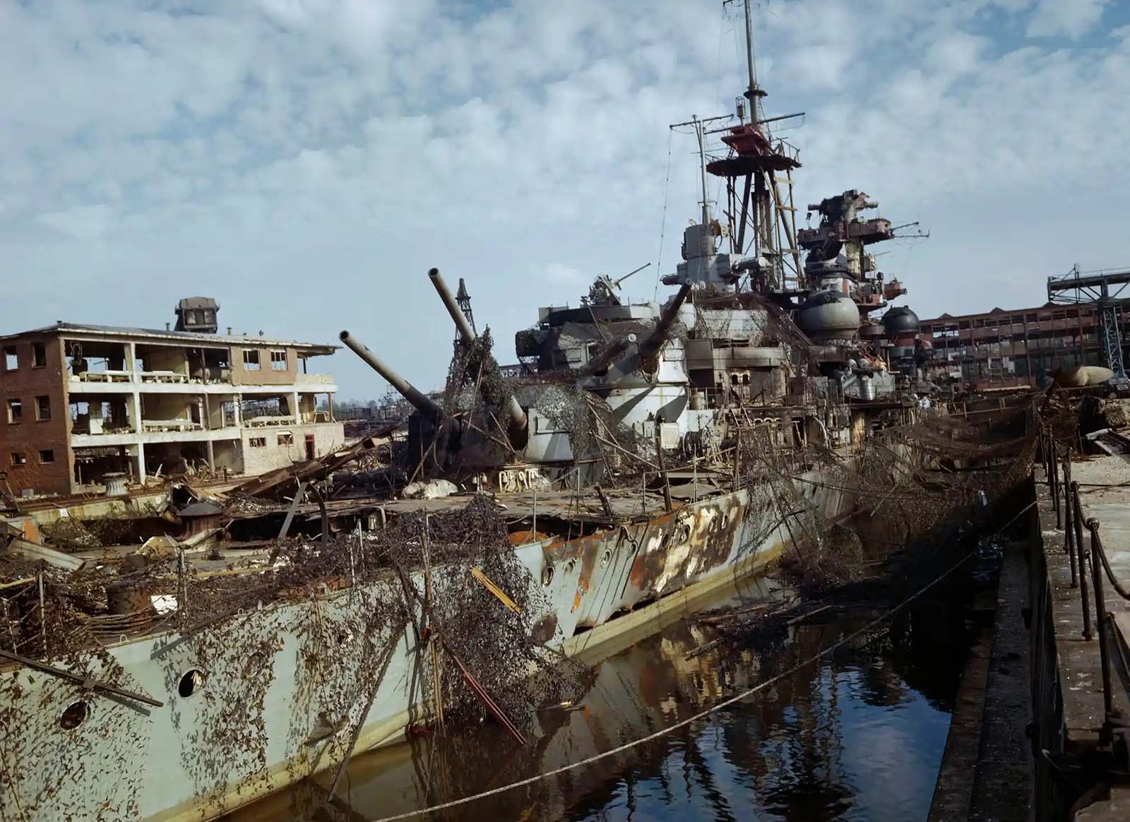 The German heavy cruiser Admiral Hipper abandoned in dry dock at Kiel, Germany, May 1945.
