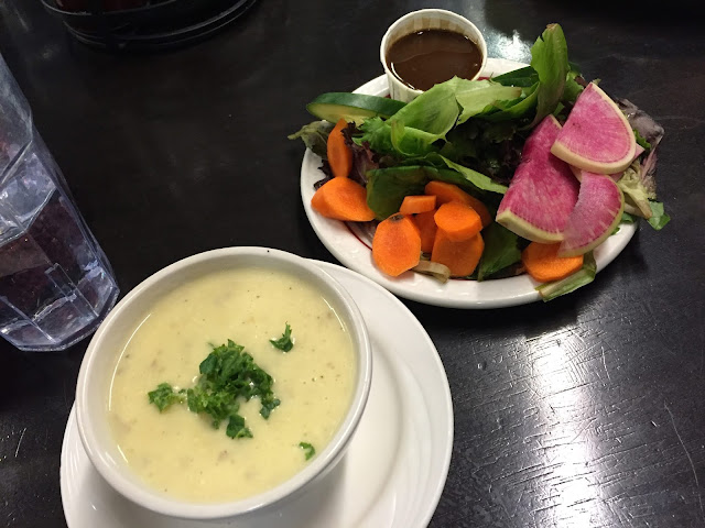 Potato leek soup and veggie side salad at Bushel and Peck's in Beloit, Wisconsin.