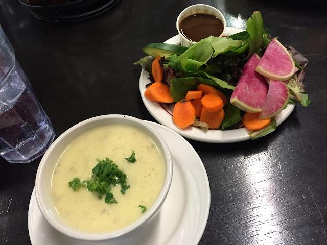 Potato leek soup and veggie side salad at Bushel and Peck's in Beloit, Wisconsin.