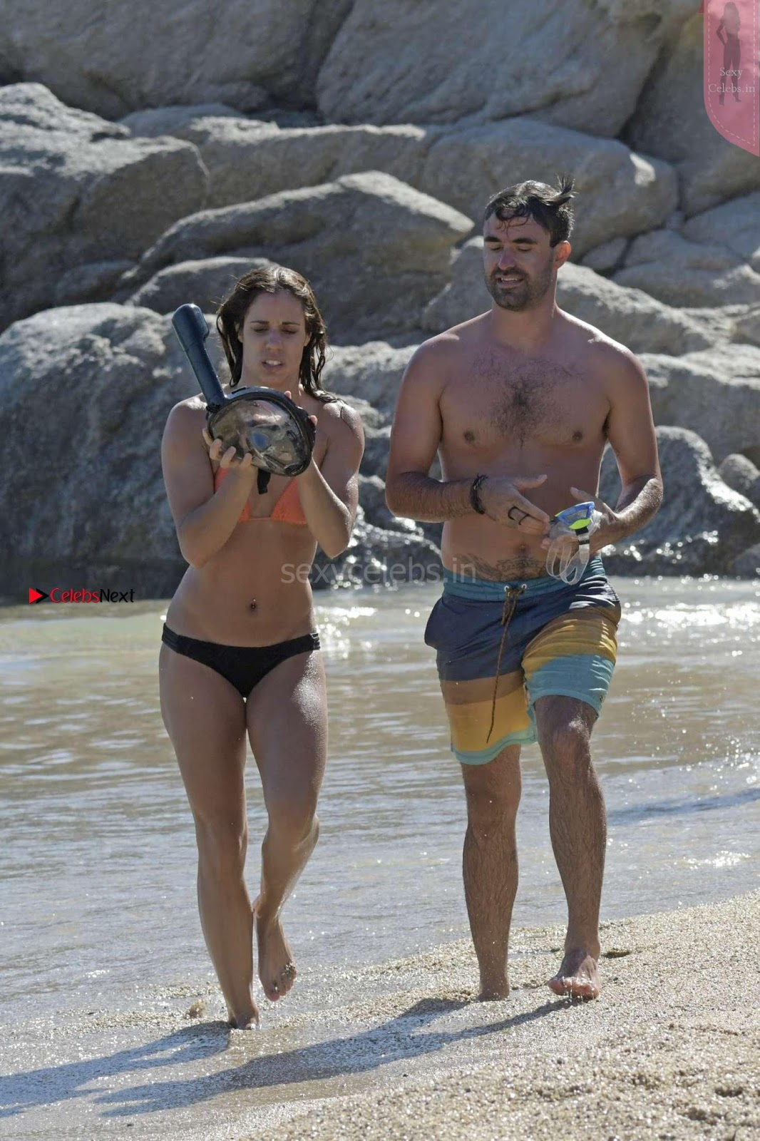 Katerina Stefanidi in orange wet Bikini withj Boyfriend Sex and fun boobs ass on the beach in Mykonos