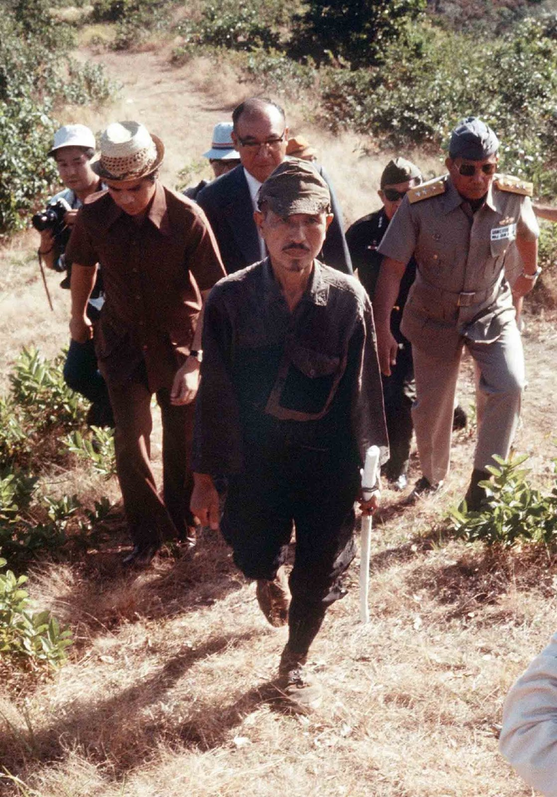Lt. Hiroo Onoda, sword in hand, walks out of the jungle on Lubang Island after a nearly 29-year guerrilla campaign.