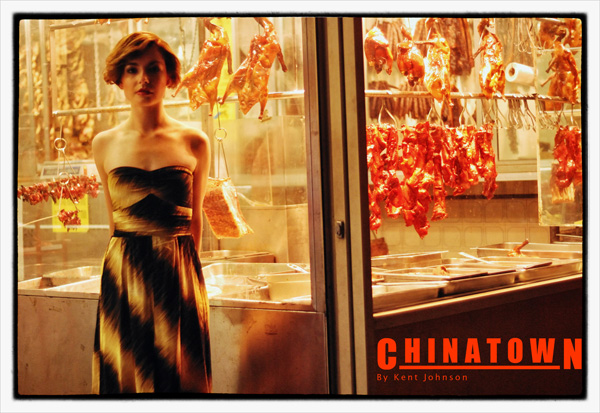 Opening title shot for Chinatown 2007-2020. Fashion model in front of Chinese BBQ  shop with BBQ ducks hanging in the window at night. Photography by Kent Johnson.