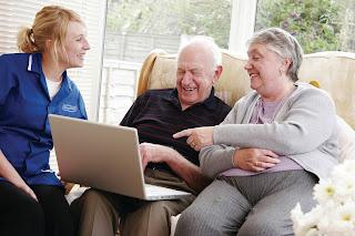 Caremark carer helping customers