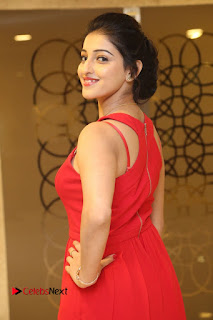 Actress Mouryani Stills in Red Dress at Intlo Deyyam Nakem Bhayam Trailer Launch  0028