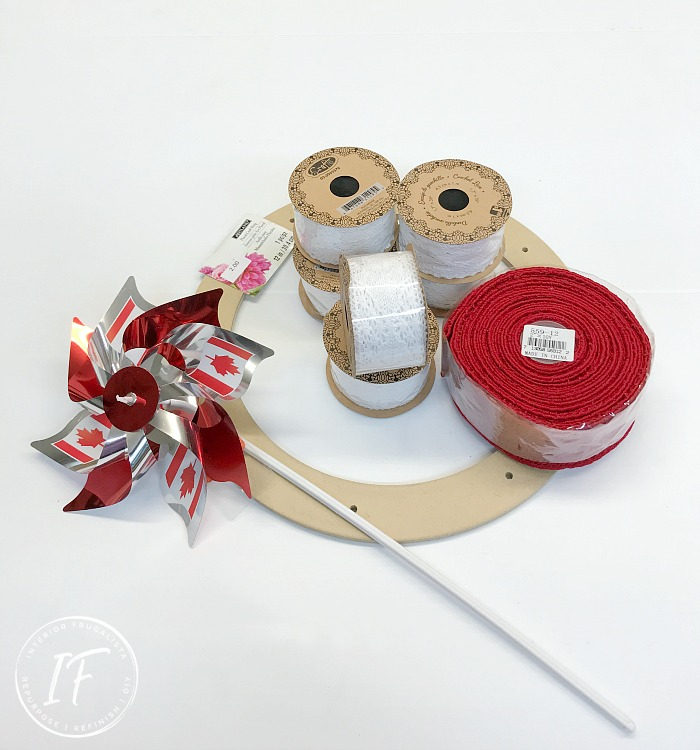 An easy and affordable handmade Patriotic Ribbon Wreath for Canada Day with a cute maple leaf banner that can easily be adapted for the 4th of July.