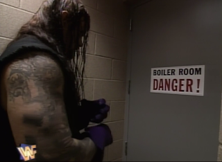 WWF / WWE SUMMERSLAM 1996 - The Undertaker enters the boiler room for his match with Mankind