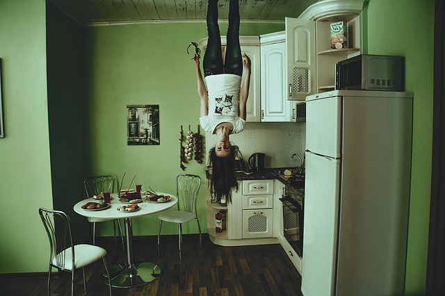 Girl Hanging Upside Down from Ceiling
