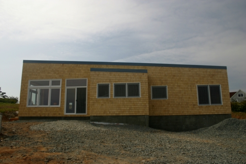 Front view of house, cedar shake and metal roof finished from Scotia Metal Products.