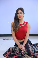 Telugu Actress Nishi Ganda Stills in Red Blouse and Black Skirt at Tik Tak Telugu Movie Audio Launch .COM 0164.JPG