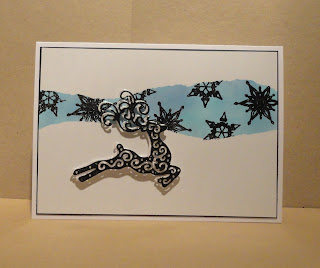 Christmas card with blue panel, black glitter snowflakes and reindeer