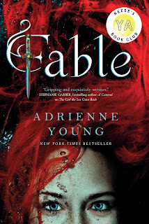 top half of the face of a girl with crimson red hair. Fable written in curly script lettering