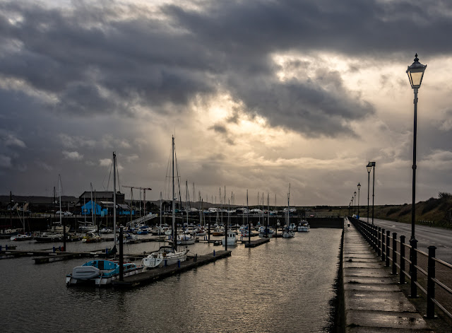 Photo of Maryport Marina looking empty now many of the boats are out on the hard standing