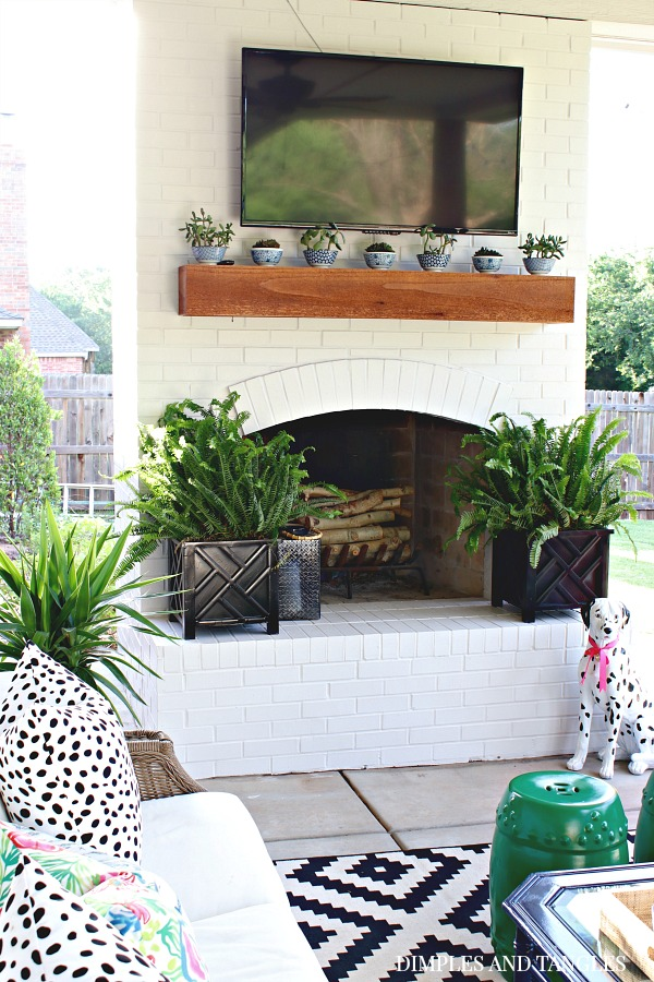 White painted outdoor fireplace