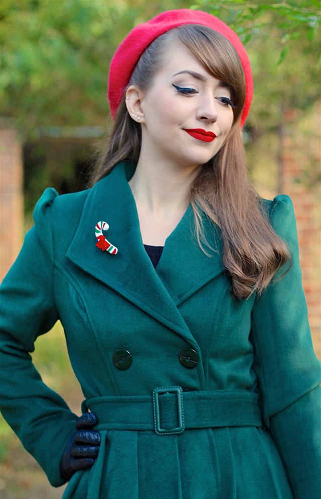 Hearts and Roses London swing coat in green, Erstwilder candy cane brooch