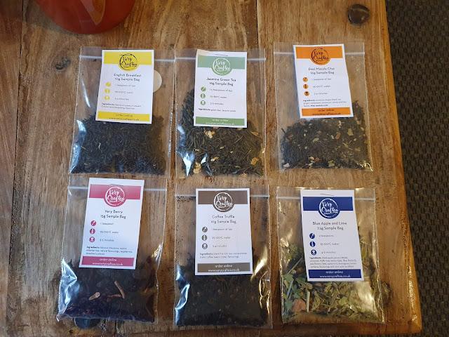 6 loose tea samples on table