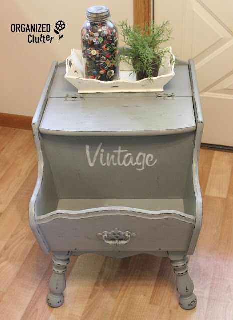 Photo of a colonial style end table with faux distressing