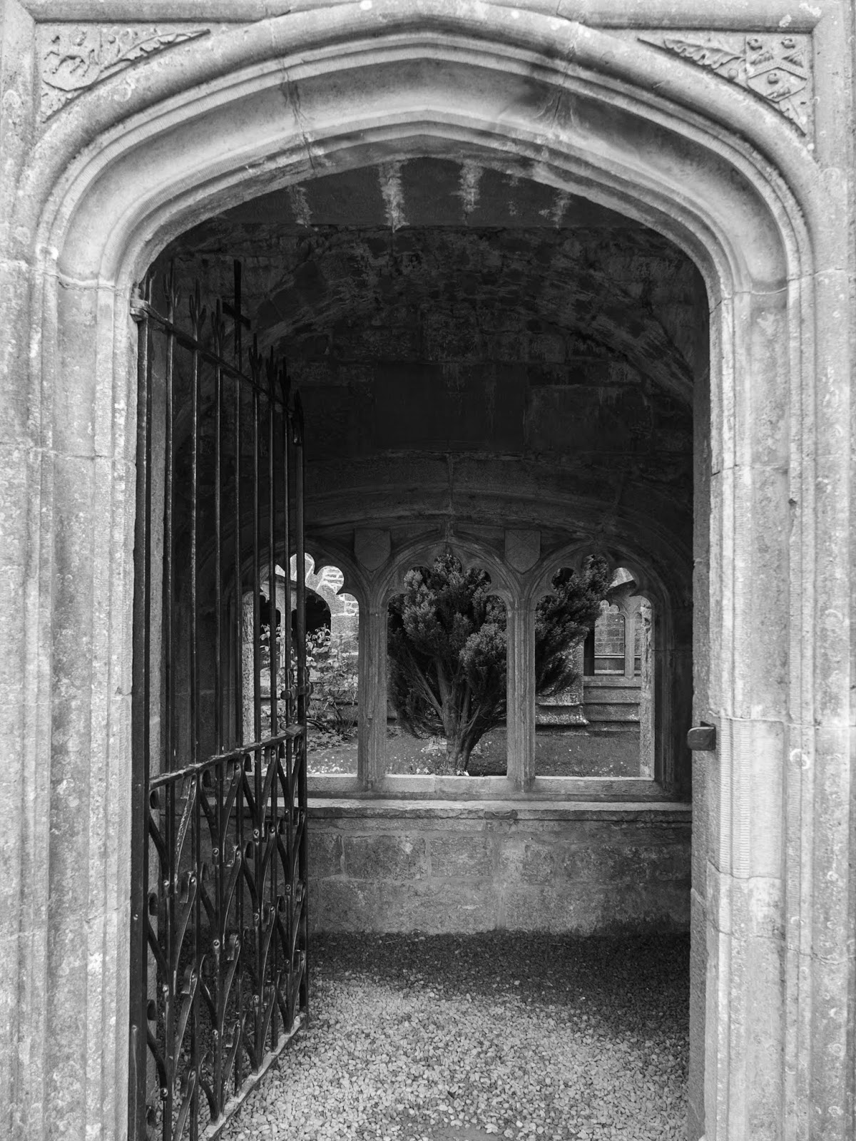 An open gate leading into an Abbey cloister square in Adare, Co.Limerick.