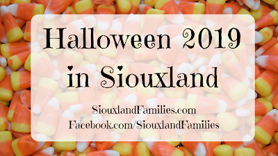 "against a background of candy corn, the words ""Halloween in Siouxland 2019"""