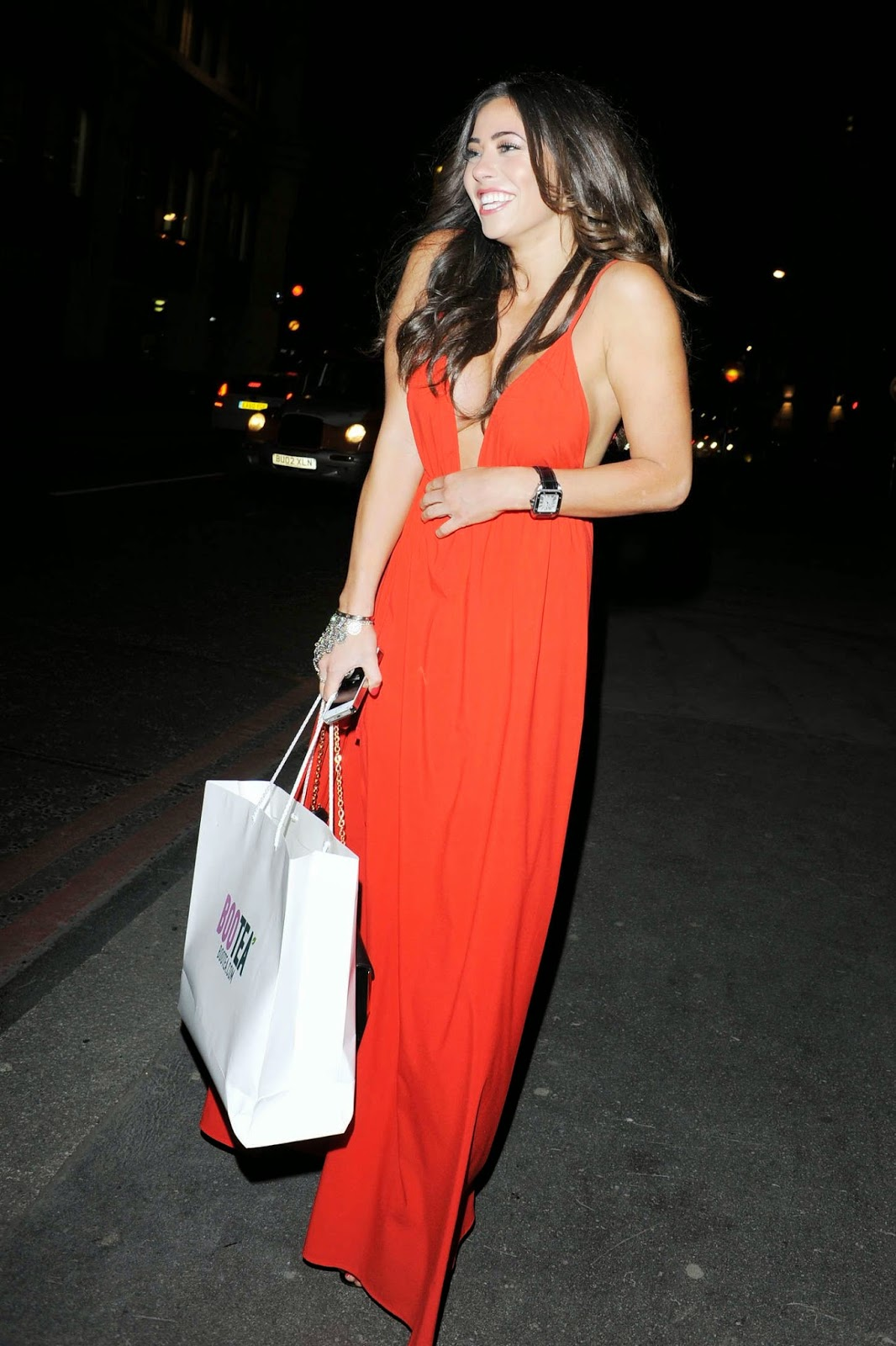 Pascal Craymer in a plunging red dress at The Sun: Bizarre Party in London