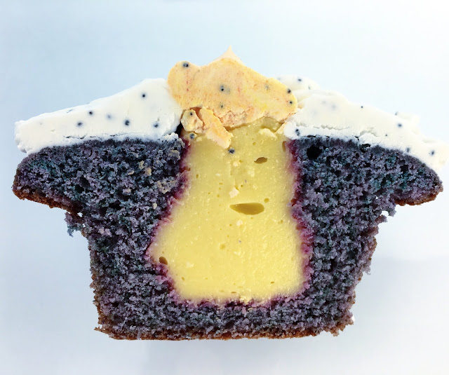 Cross Section of Lemon Cream-Filled Blueberry Cupcakes with Poppy Seed Buttercream