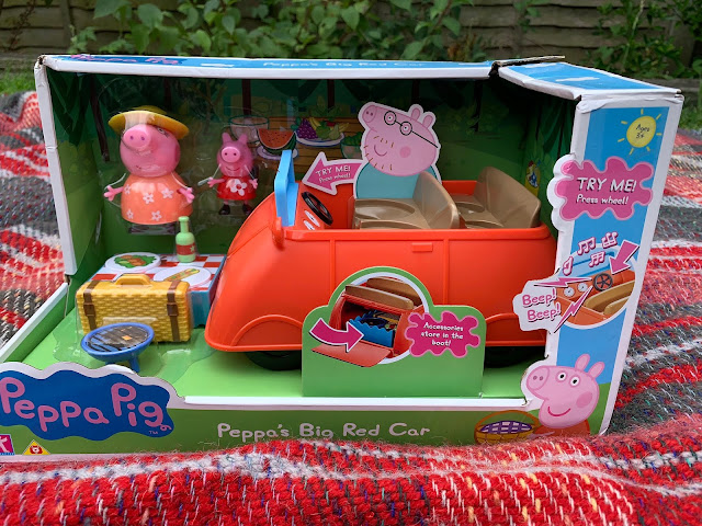 Peppa's Big Red Car Plastic Toy in the packaging on a picnic blanket