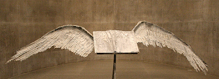 cropped photo of sculpture of book w wings