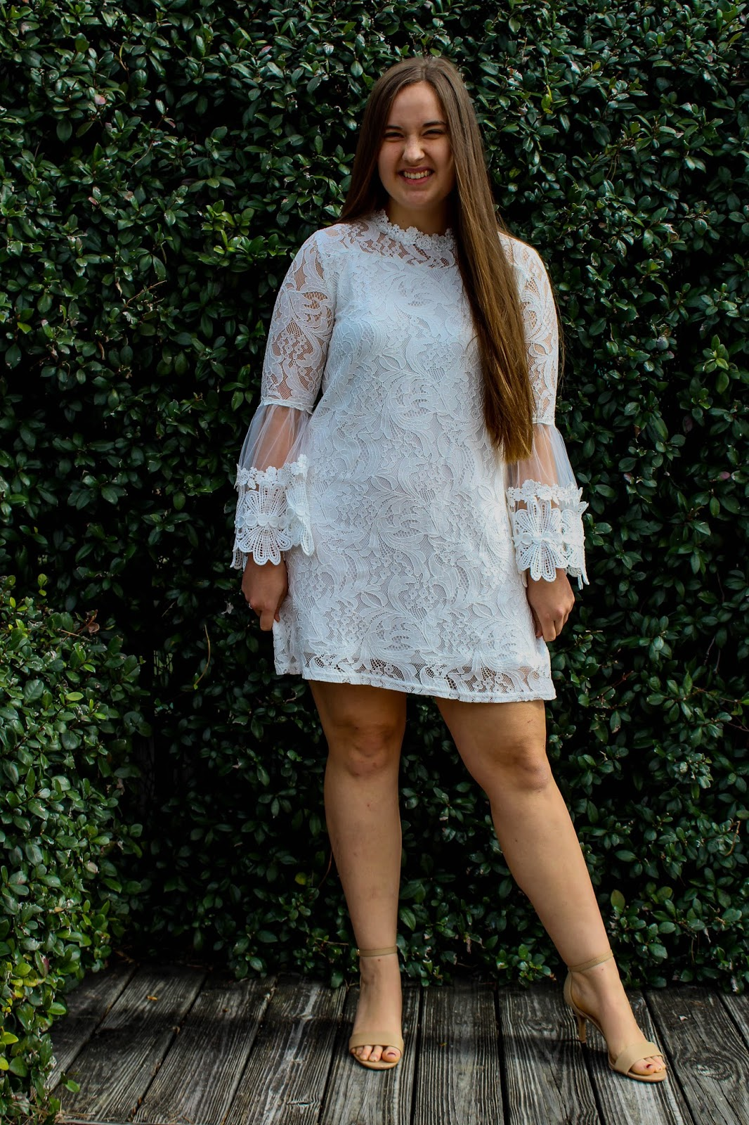 Girl wearing white bell sleeve dress