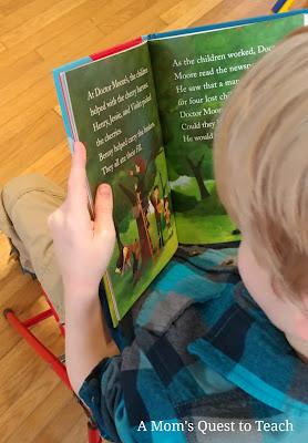 child reading Boxcar Children book