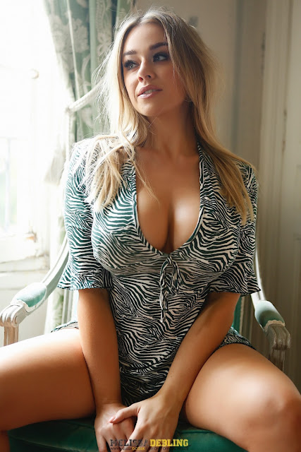Melissa Debling sexy big tits cleavage posing on chair