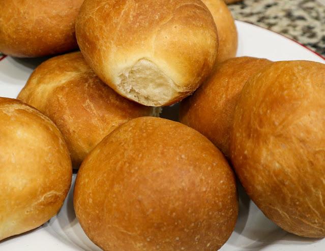 fresh brioche buns on a plate