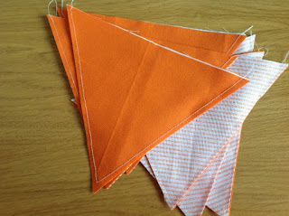 triangle sof fabric showing seams