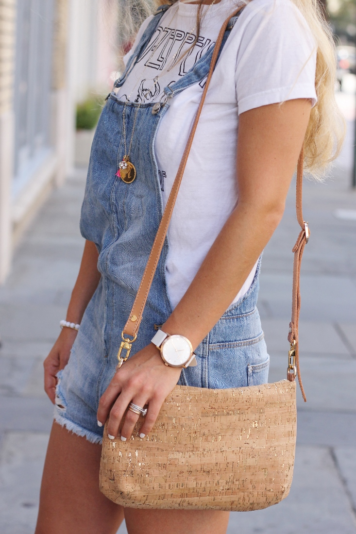 gold metallic cork handbag with overalls and tshirt