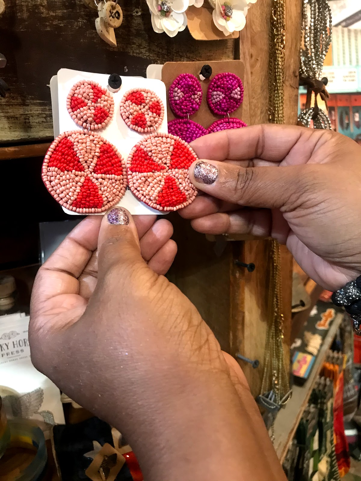 Earrings at the Dallas Farmers Market on display. Written for City Diaries