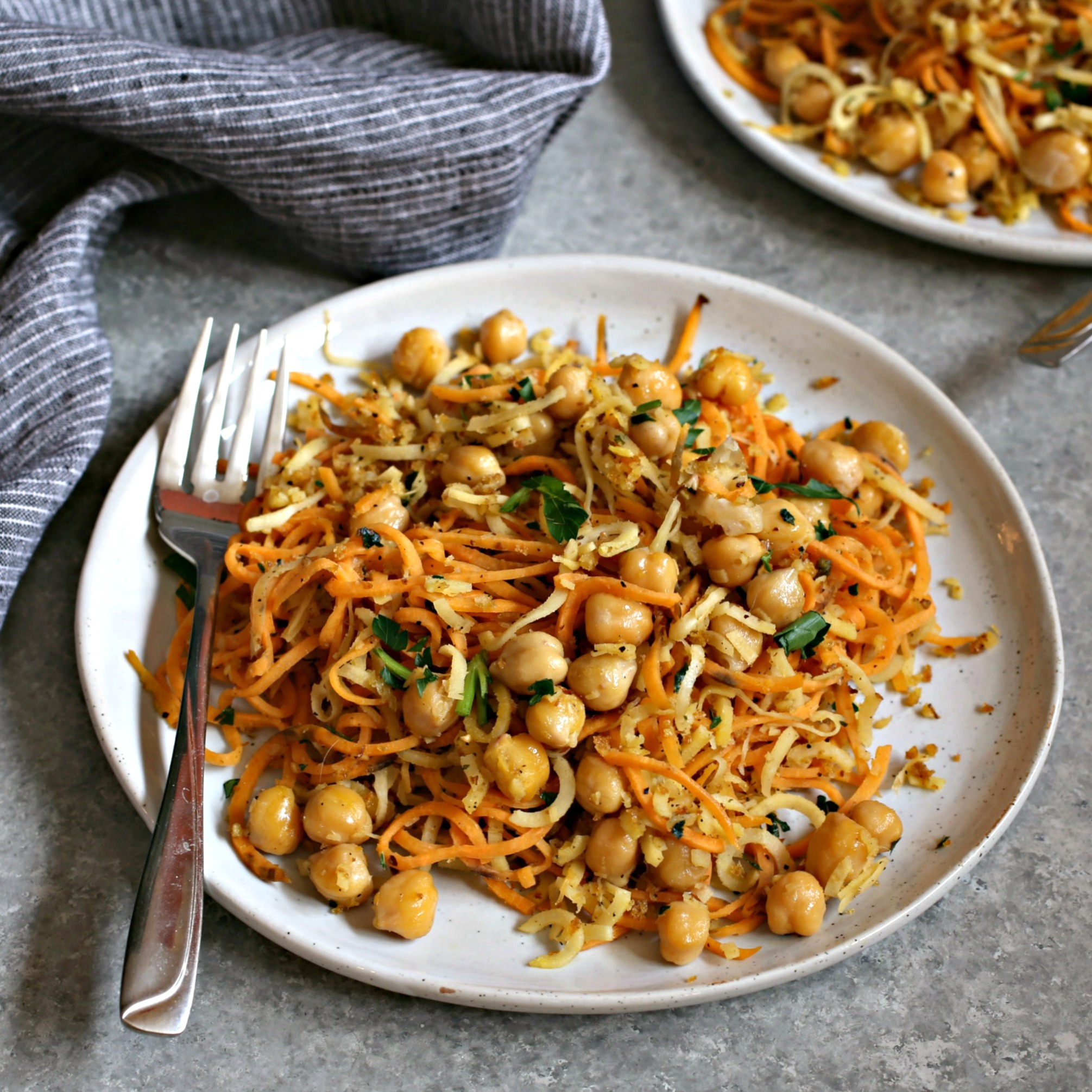 Recipe for spiralized sweet potatoes and parsnips with chickpeas and a crispy breadcrumb topping.