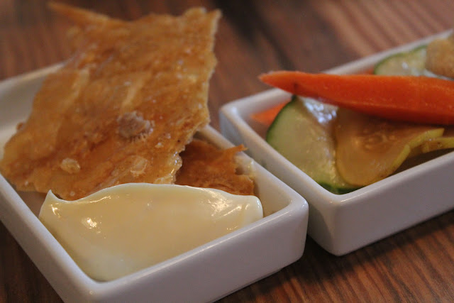 Fried chicken skin and pickled vegetables at West Bridge, Cambridge, Mass.