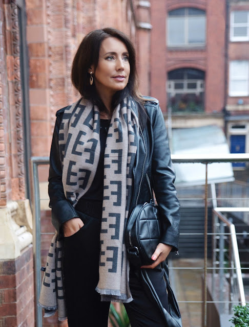 woman in scarf and leather jacket