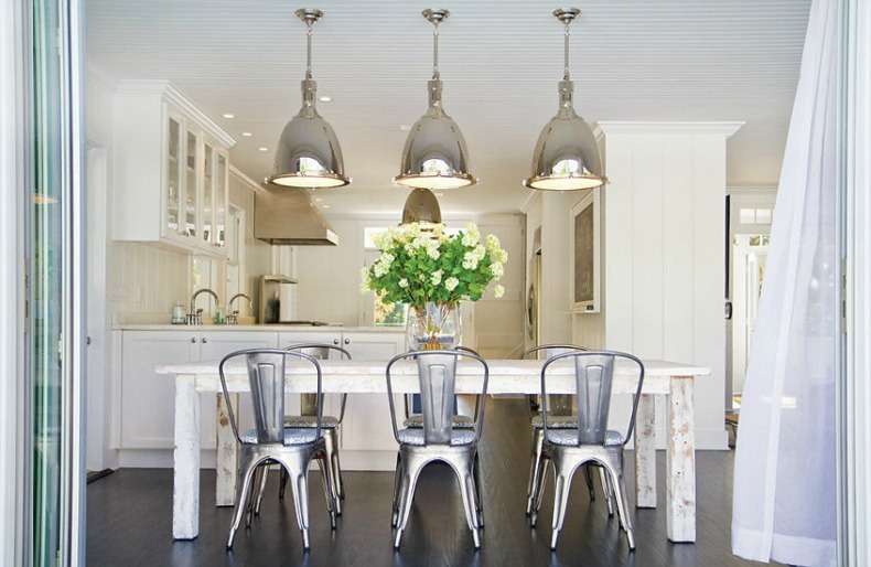 Coastal kitchen with nauitcal lighting and a mixture of old and new furnishings