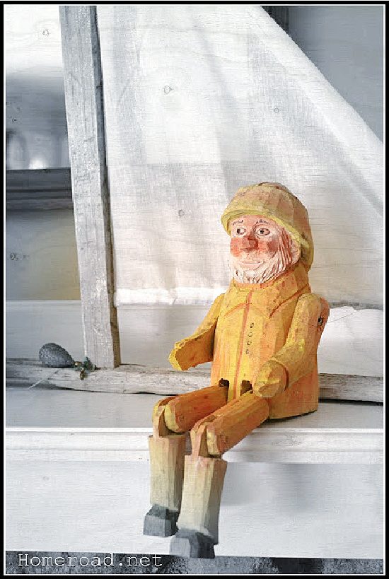 carved fisherman on the mantel